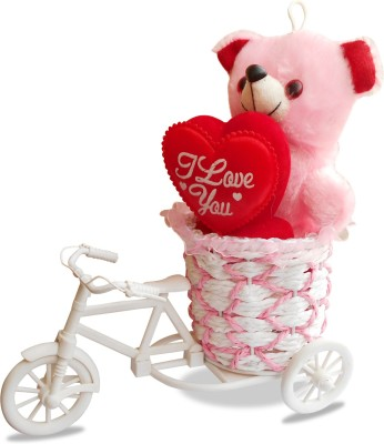 SKY TRENDS Cycle With Heart Teddy Romantic Gifts For Valentine's Day Valentine Gift Set.  This gift description A cycle-rickshaw and a teddy bear in a bucket sitting over it. And a heart handling by a teddy bear